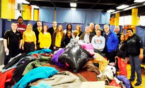 CertaPro staff with donated coats